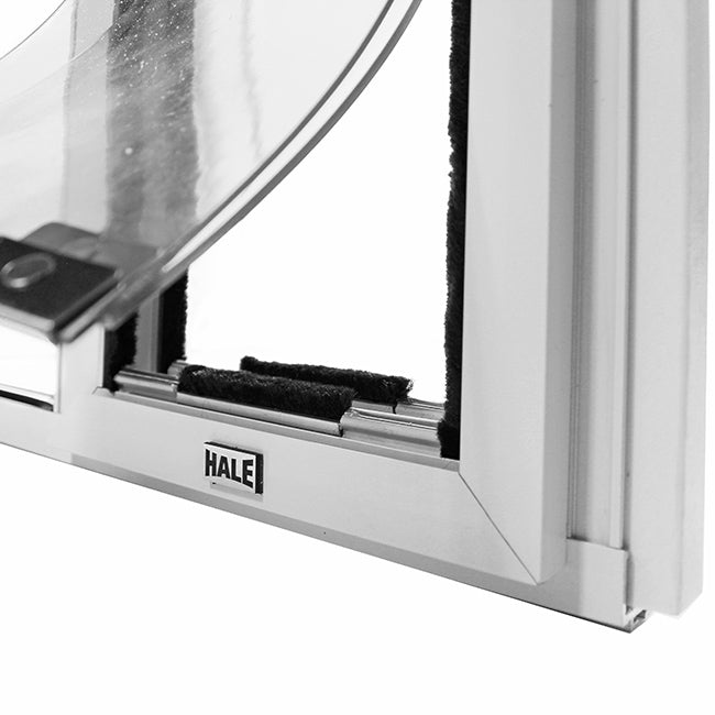 "The Hale ""Omni"" Pet Door for Sash Windows is lined with weatherstripping for increased insulation and magnets for a weather resistant seal"