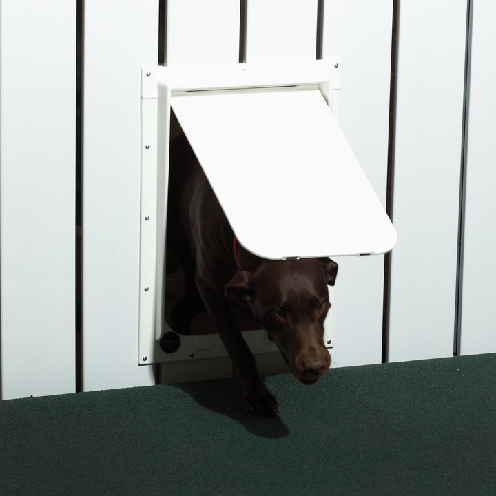 The Magnador Dog Doors for Doors & Kennels (seen here in white) can be installed into walls, doors, kennels, and more