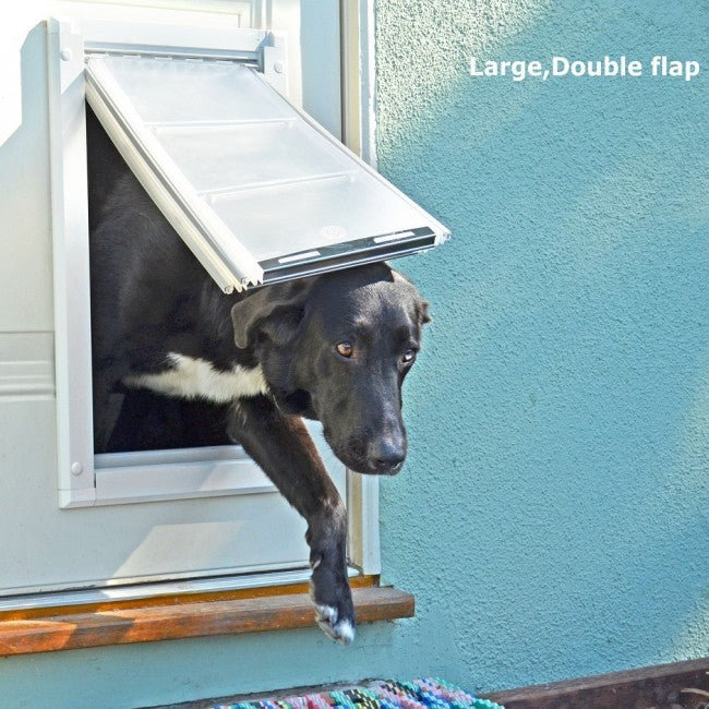 dog using endura door mount pet door