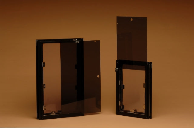 The custom Hale dog door comes with a locking cover that works with the door's secure pin lock