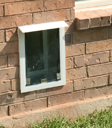 Dog door in brick - how to cut a hole in brick wall for dog door through wall