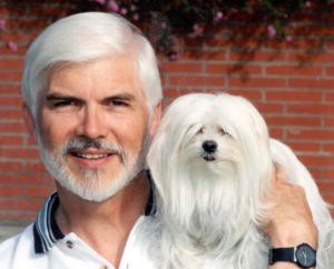 A man with his dog - funny dog and owner pose