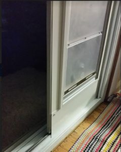 view of the sliding glass door bottom track for how to install a sliding door monorail panel