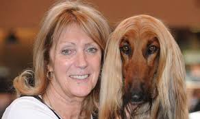 A woman with her dog - why do dogs look like their owners so much?