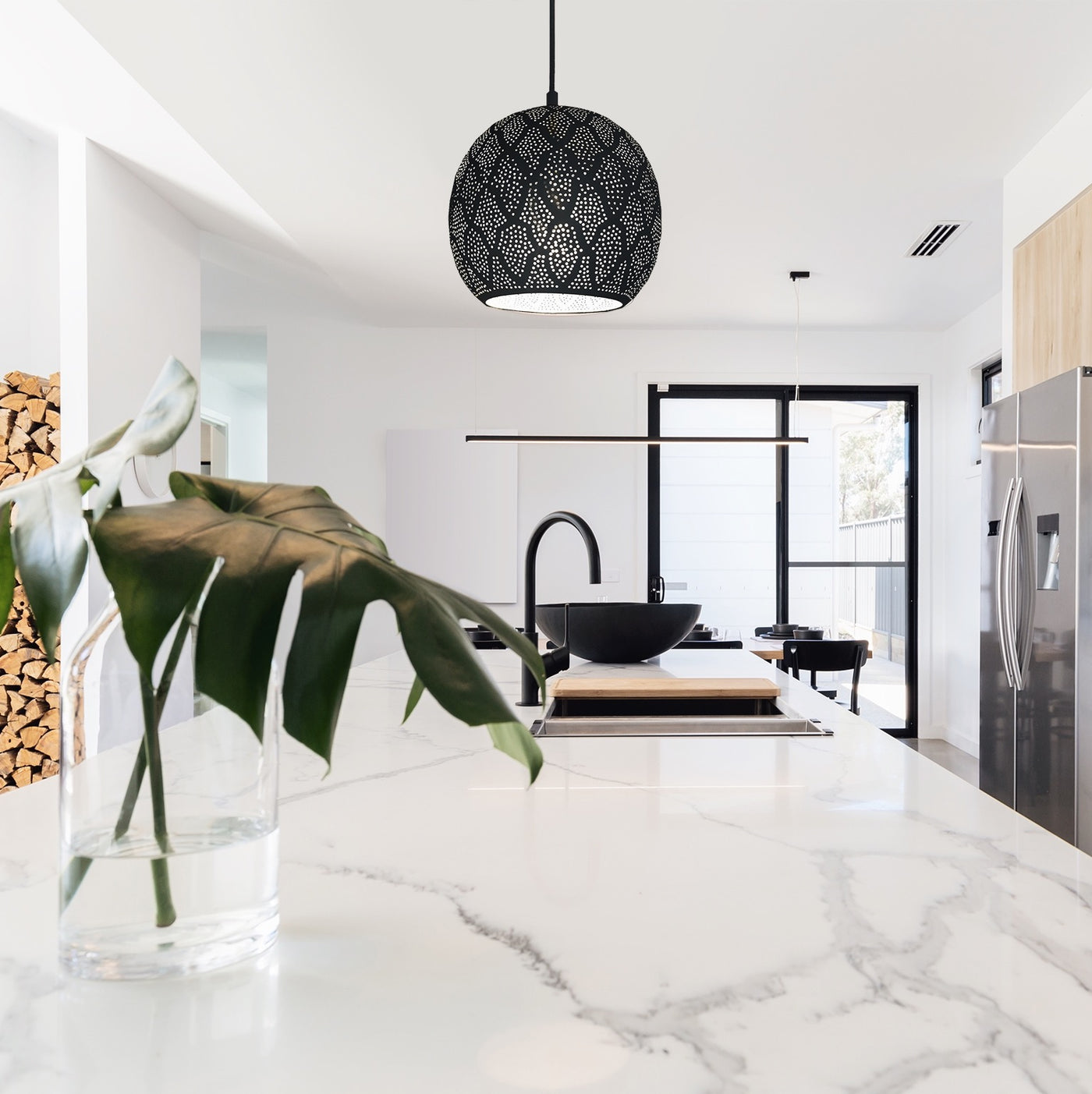 Modern kitchen with a rounded metal pendant light