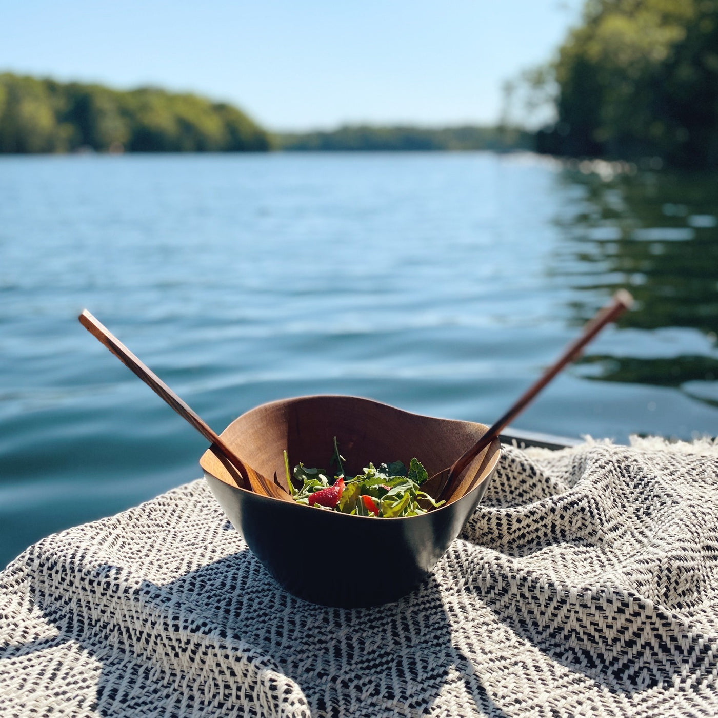 Mahogany salad bowl near a lake