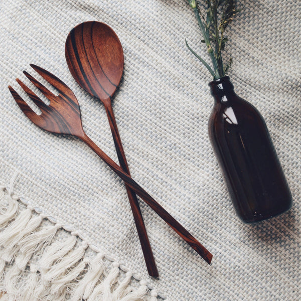 Wooden salad servers on a fabric napkin