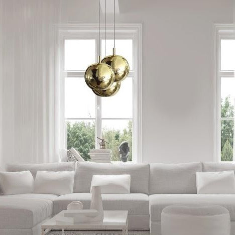 White living room with brass pendant lights