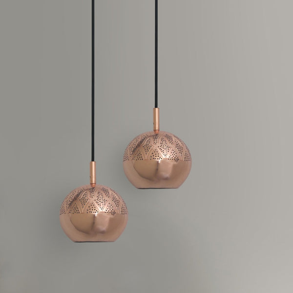Two copper patterned pendant lights