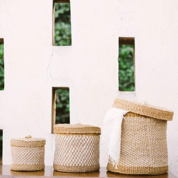 Three woven lidded baskets
