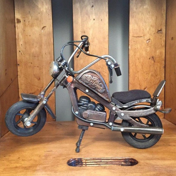 Antique metal motorcycle decor item