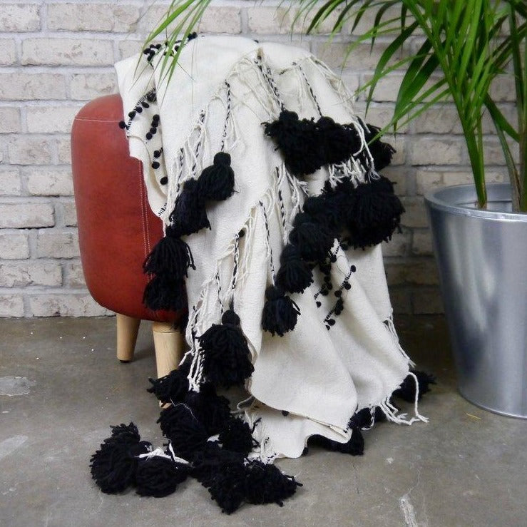 Black and white textured blanket on a stool
