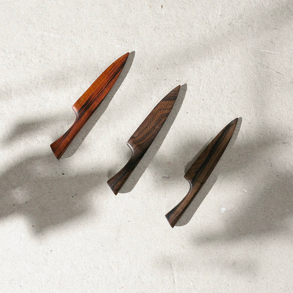 Three wooden kitchen knives