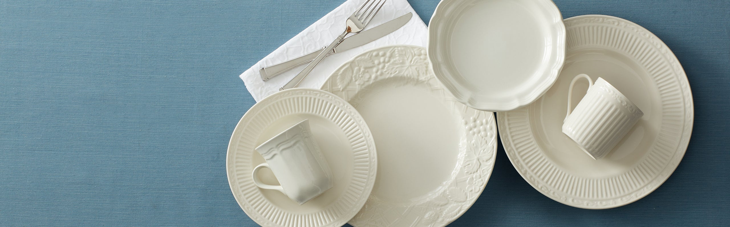 Mikasa Patterns and Collections, featuring our Countryside dinnerware, in shades of soft white with fluting, embossed fruit, and crimped edging.