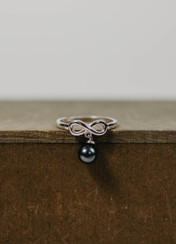 Infinity Ring with a Dangling Black Pearl - simple pearls