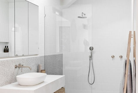 Bathroom interior showing mirrors cleaned with ammonia