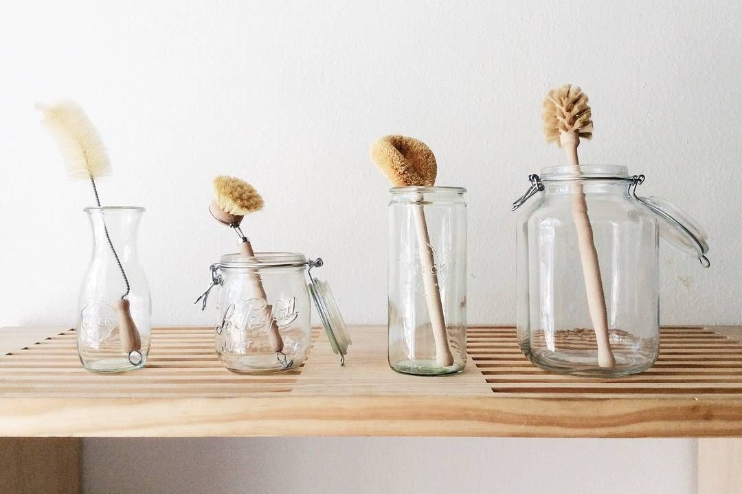 Natural cleaning brushes in jars