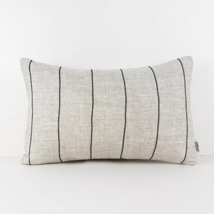 Beige linen lumbar cushion with vertical black stripe