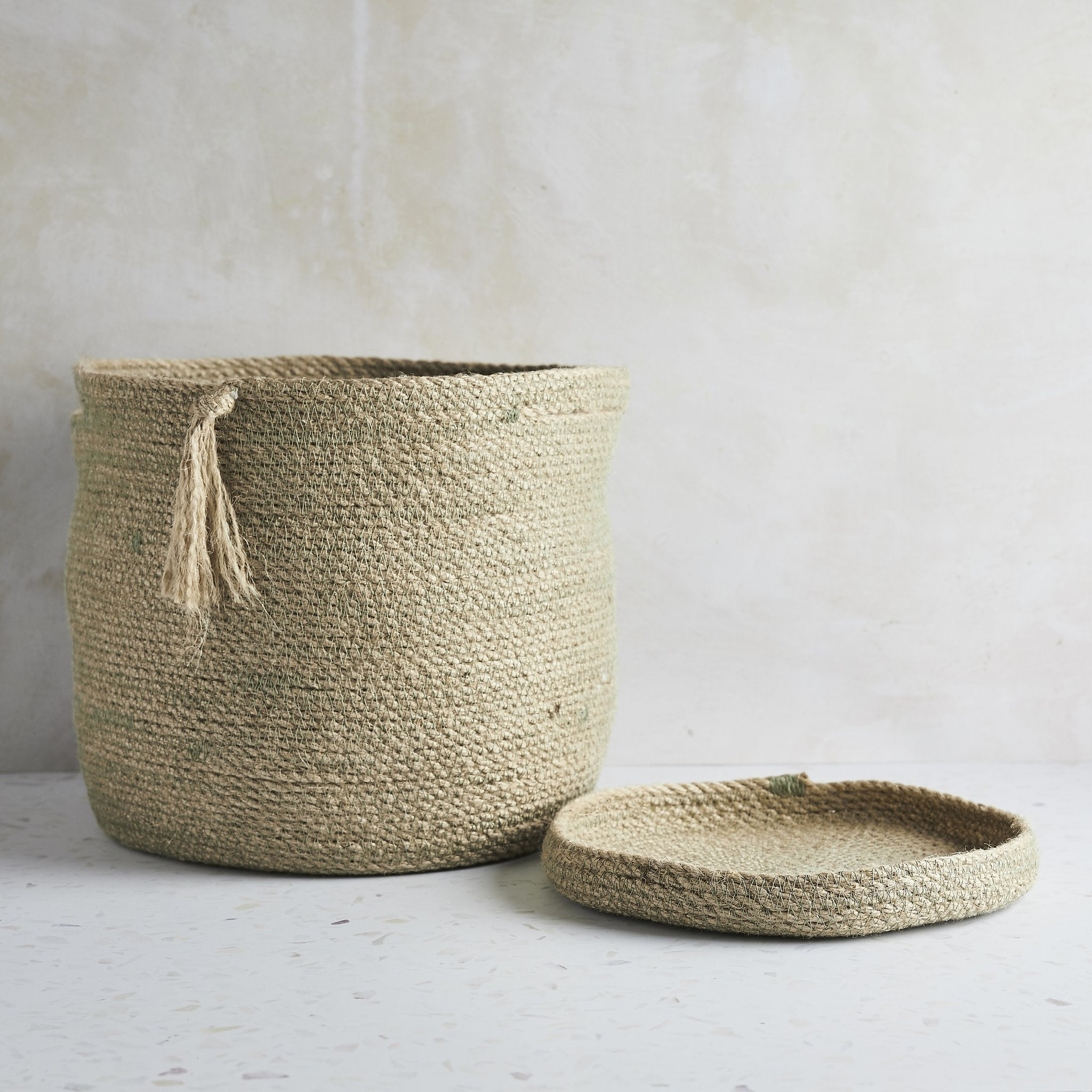 Eco-Twist trinket tray next to woven jute basket