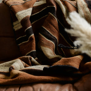 Cosy, textured alpaca wool throw in brown, cream and umber stripe