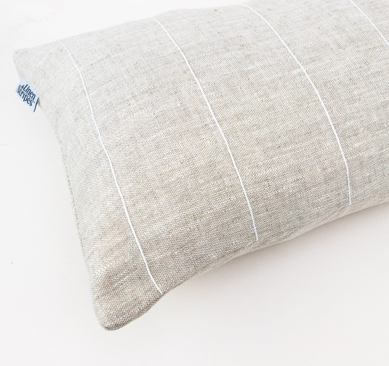 Natural linen cushion with white stripe