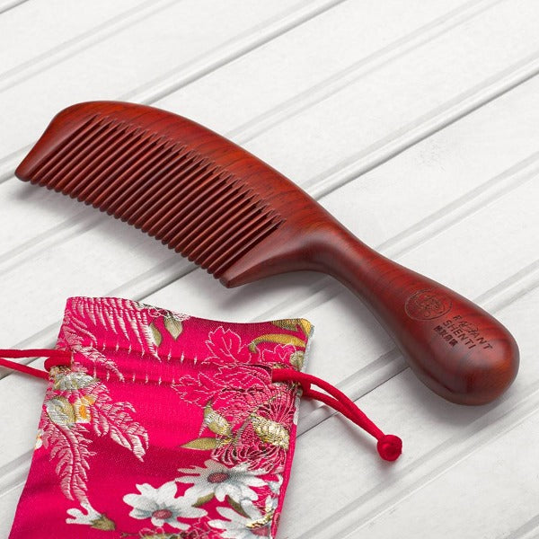 Rosewood comb with handle narrow teeth brocade bag front view with radiant shenti logo