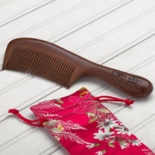 Load image into Gallery viewer, Handmade sandalwood comb handle narrow teeth front view with radiant shenti logo