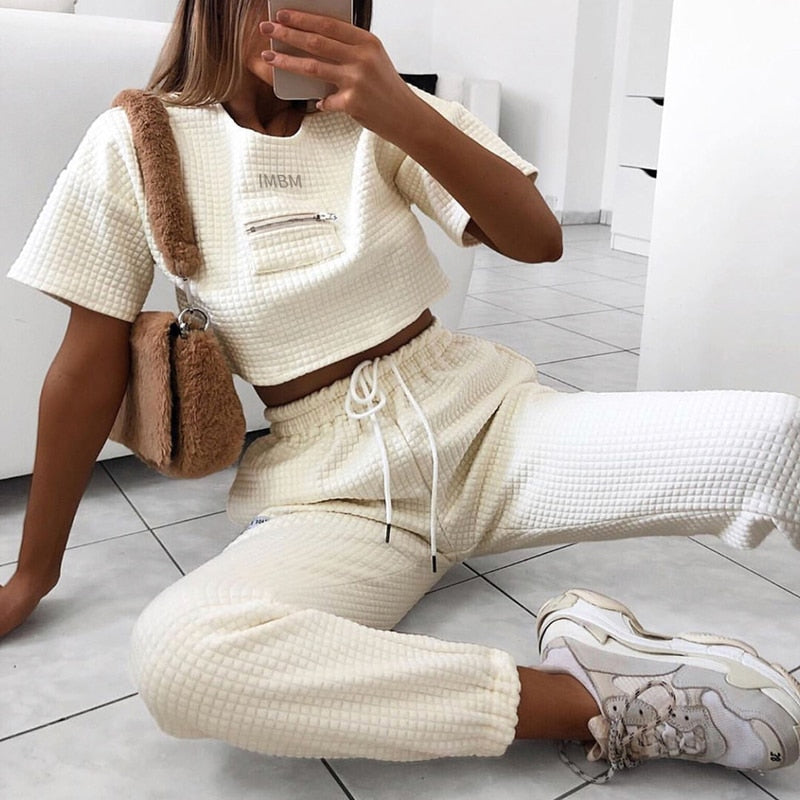 Solid color round neck stitching short top suit