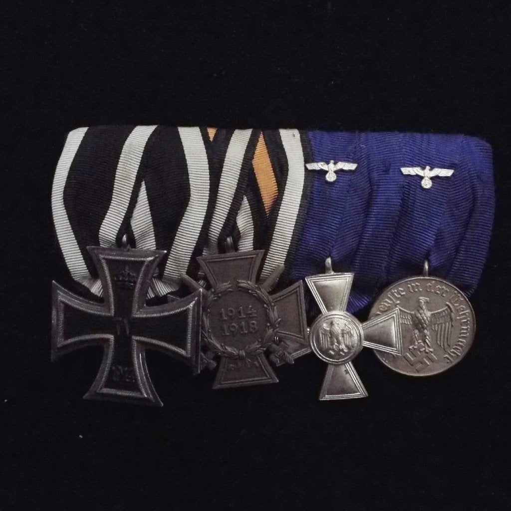 Imperial & Nazi German group of 4. Iron Cross 1914 (2nd class), Cross of Honour (1934), Army 18 Year Long Service (with eagle) & 4 Year Service Medal (with eagle) 3rd Reich issues