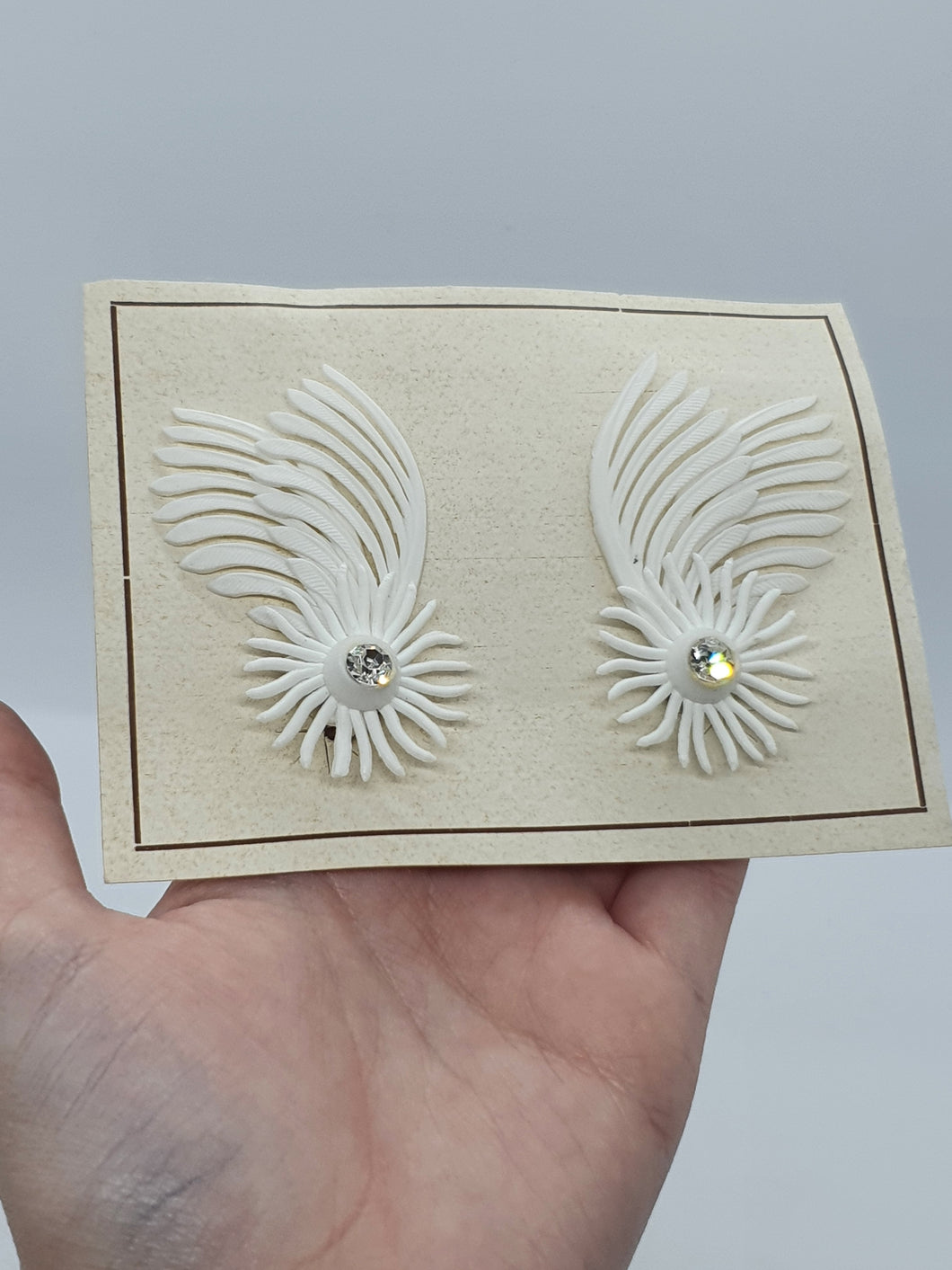1950s Deadstock Plastic White Feather Clip Earrings