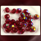 Czech Glass Beads: Trans. Siam Red AB, Faceted Round, 6mm (Bag of 25)