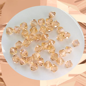 Swarovski 5328 Xilion Beads: 4mm Bi-cone / Pack of 40 / Light Peach