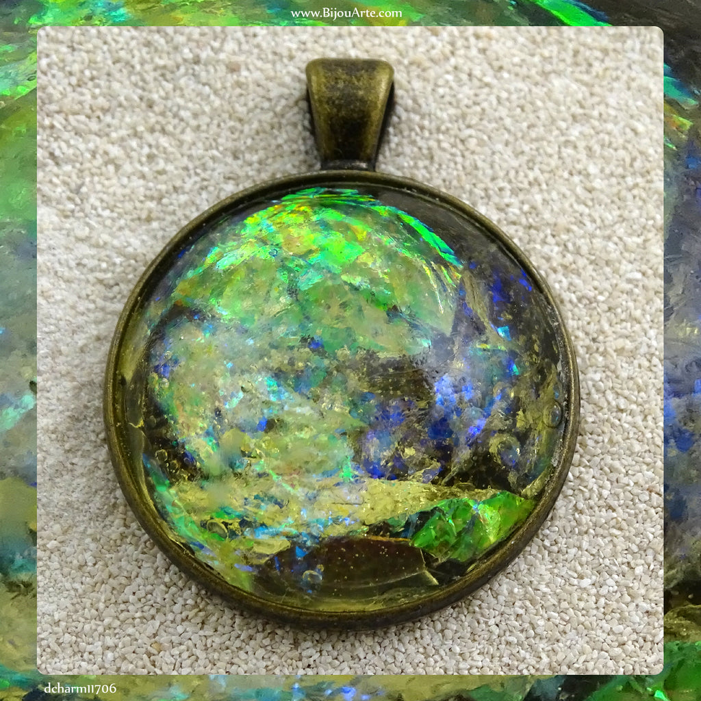 Antique-Bronze Plated Pendant: Lazer Paper Set In Resin