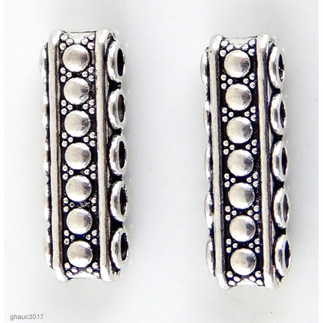 "High quality Zinc alloy ""Zamak"" beads with silver-plated finish.  Each bead measures 23mm end-to-end."