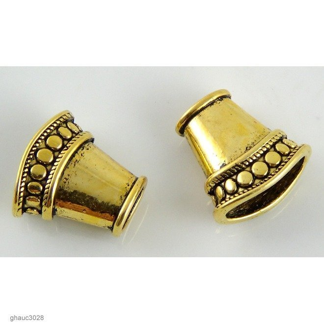 Antique-brass plated zinc alloy, Bali-style cones.  Each bead measures 13mm end-to-end.