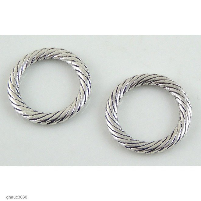 Antique-silver plated zinc alloy link.  Each bead measures 24mm end-to-end.