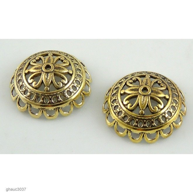 Antique-brass plated zinc alloy filigree bead caps.  Each bead measures 24mm end-to-end.
