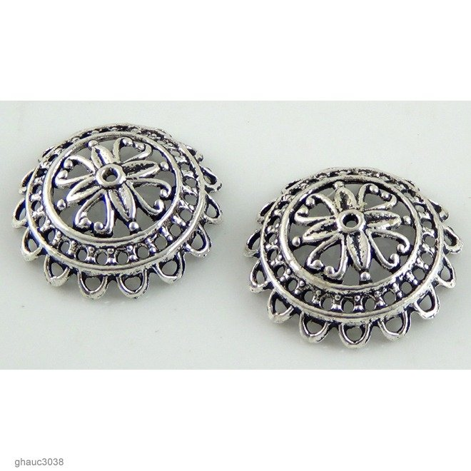 Antique-silver plated zinc alloy filigree bead caps.  Each bead measures 24mm end-to-end.