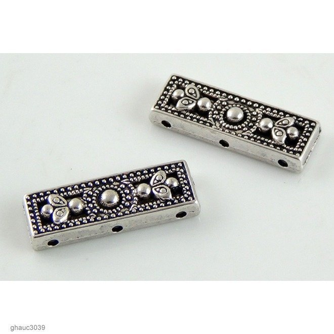 Antique-silver plated zinc alloy, Bali-Thai style flat, 3-hole spacer bars.  Each bead measures 26mm end-to-end.