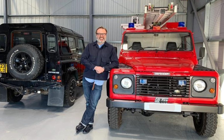 Hummingbird founder standing next to two cars