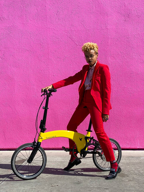 Woman in red suit sitting on Hummingbird electric bike