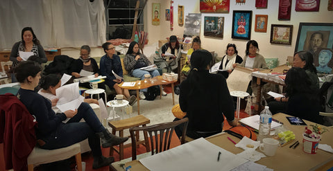 Womxn sharing stories and art making during a workshop with Cynthia Tom