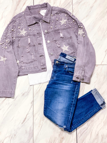 Pearl embellished and embroidered denim jacket in grey/purple with white tank top and blue jeans.