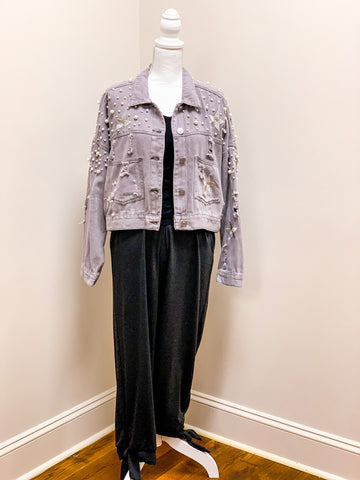 Pearl embellished and embroidered jean jacket in grey with distressing, paired with black ankle tie joggers.