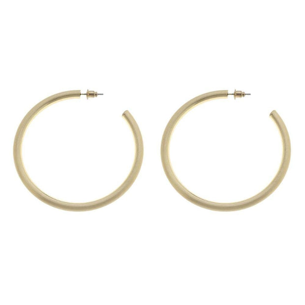 Fruit of the Vine's Camille Hoops are large (2 inches in diameter), open, gold hoops with a matte, or brushed, texture.