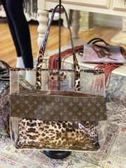 Upcycled designer handbags fruit of the vine online repurposed LV tote clear with cheetah leopard trim and insert pouch