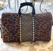 Repurposed, Upcycled Louis Vuitton Monogram on Hair on Hide Duffle bag in Dark Leopard Print with handles and shoulder strap. Gold studs.