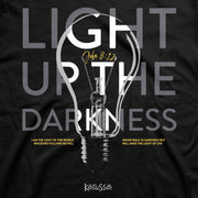 "John 8:12 Christian Graphic Tee. Black with lightbulb and ""light up the darkness"""