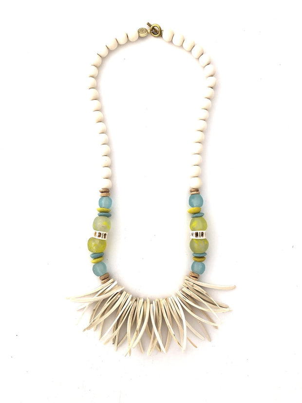 Long beaded necklace with white beads, blue and green recycled African glass beads, and white colored coconut wood beads.