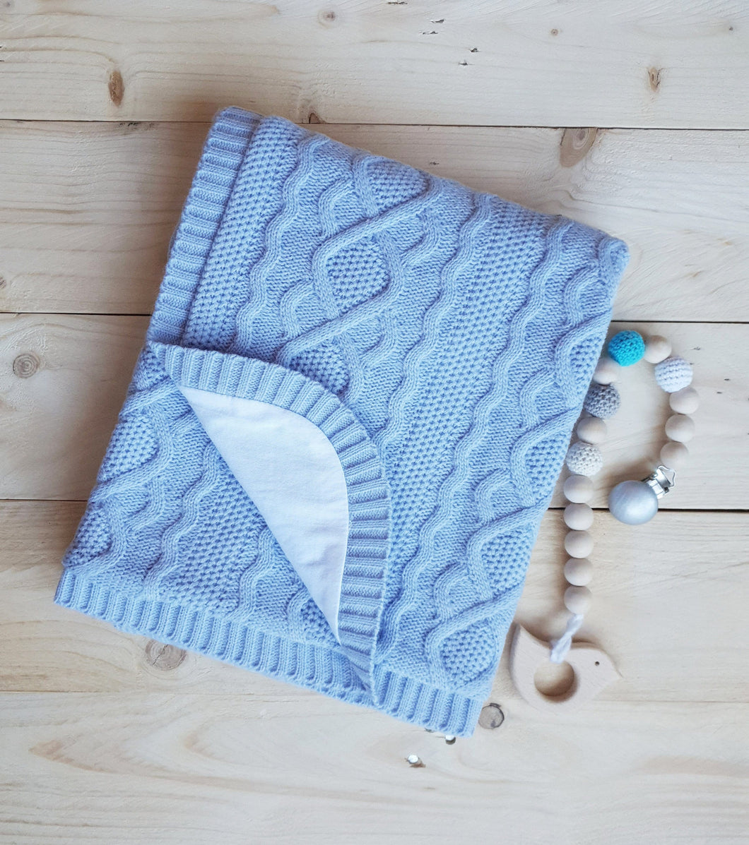 Knitted baby blanket with cotton lining